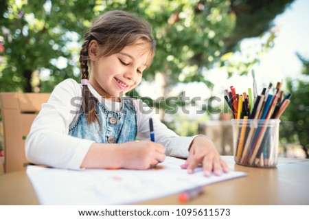 Child Girl Drawing Picture Outdoors in Summer
