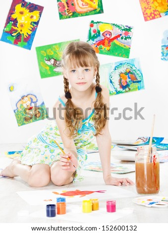 child girl drawing with color paint brush. Children art and creativity concept.