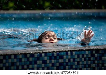 child girl drowning in pool. Stock photo ©