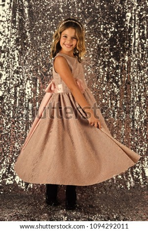 Child girl in stylish glamour dress, elegance. Fashion model on silver background, beauty. Fashion and beauty, little princess. Look, hairdresser, makeup. Little girl in fashionable dress, prom. #1094292011