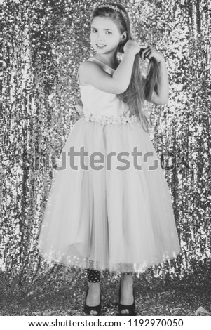 Child girl in stylish glamour dress, elegance. Look, hairdresser, makeup. Fashion model on silver background, beauty. Fashion and beauty, little princess. Little girl in fashionable dress, prom. #1192970050