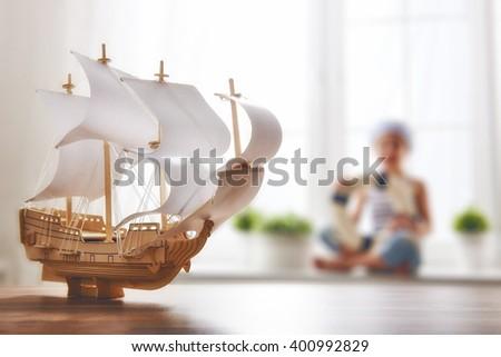 child girl making model ship....