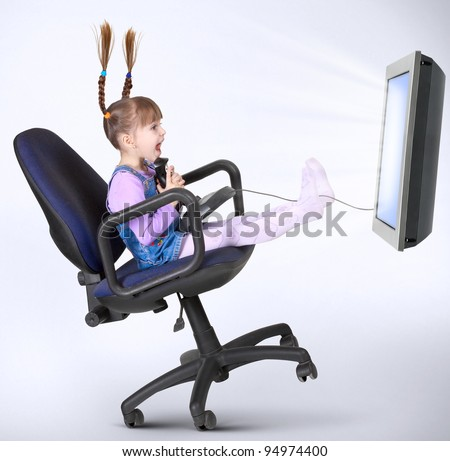 child girl playing computer game with joystick
