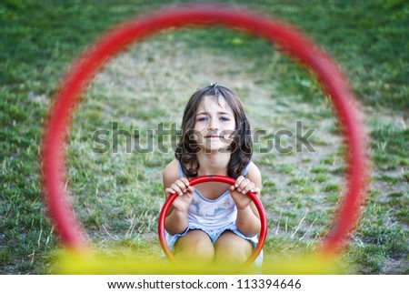 Child girl playing on a swing scales. Like targeted