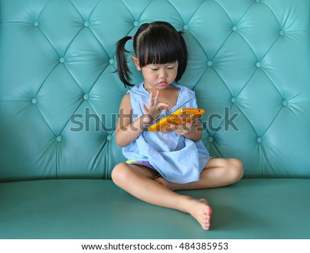 child girl using smart phone on ...