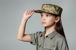 child girl wear military uniform. kid dressed like a soldier