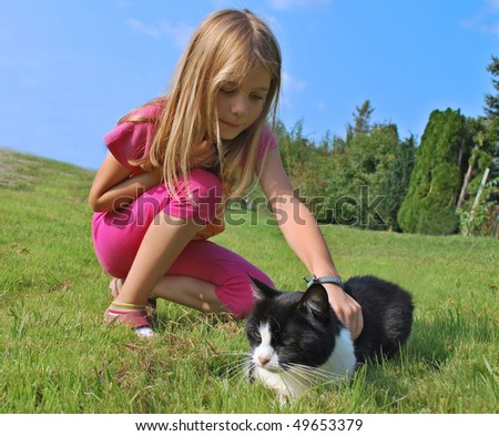 Child girl with cat