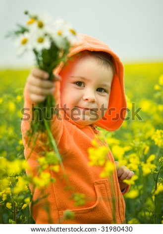 child gives a boquet - stock photo