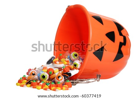 stock photo : child halloween pumpkin bucket spilling candy