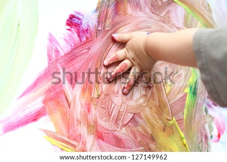 Child hand fingerpainting - stock photo