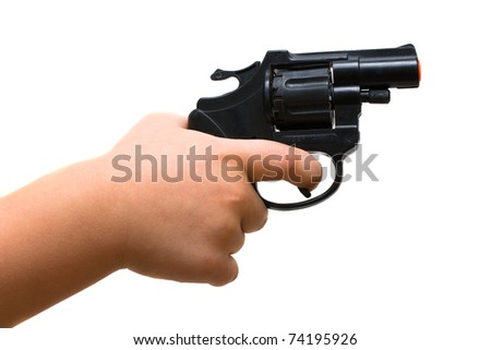 Child hand holding a toy gun. Isolated on white background