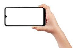 Child Hand Holding Phone Isolated on White Background. Hand of a Boy Holds Black Smartphone and Takes Pictures in the Horizontal Position. Screen Blank. Close-Up.