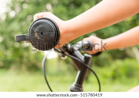 Child hand on the handlebar close up image