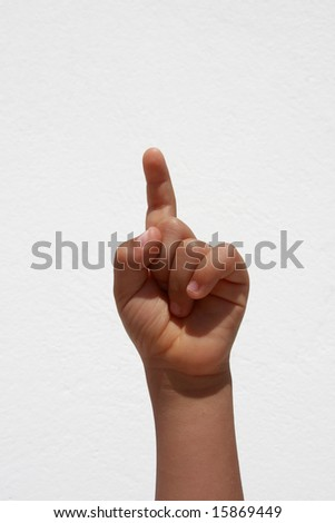 Child hand raised for answer or question