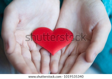 Child hands giving red heart, giving heart and love in valentine's day #1019535340