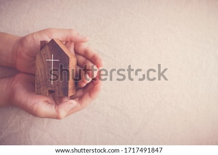 Child hands holding church, serving God, praying hands, home church community, worship together at home, streaming online church service,   Mission of gospel, social distancing concept