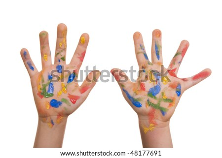 Child hands painted in colorful paints isolated on white