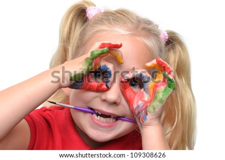 child hands with paint on fingers