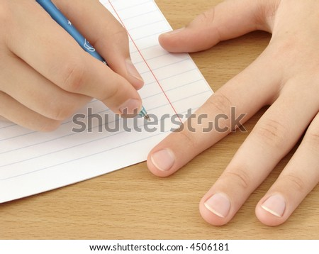 child hands with pen ready to write