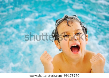 Child happiness in pool - stock photo