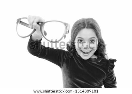Child happy with good eyesight. Eyesight and eye health. Improve eyesight. Girl kid wear big eyeglasses isolated white background. Optics and eyesight treatment. Effective exercise eyes zooming.