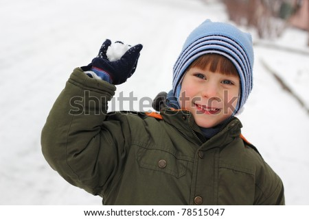 child have fun with snowball fight winter outdoor
