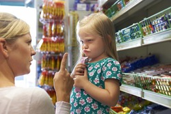 Child Having Argument With Mother At Candy Counter