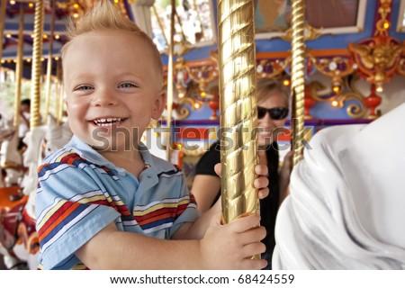 Child Having Fun on the Merry-Go-Round