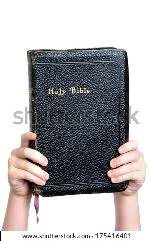 child holding bible white background - stock photo