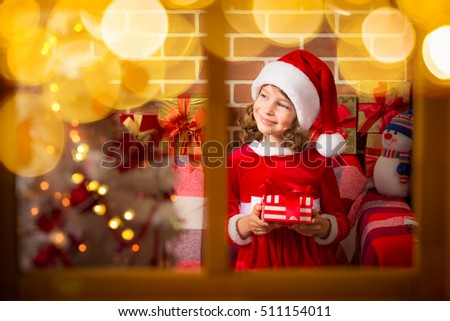 Free photos Happy child holding Christmas gift. Kid playing at home ...