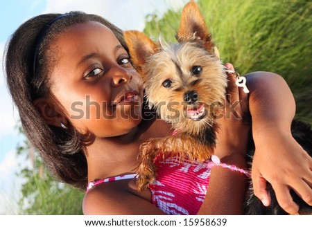 Child Holding her Yorkie