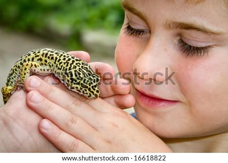 Child holding Leopard Gecko Lizard - stock photo