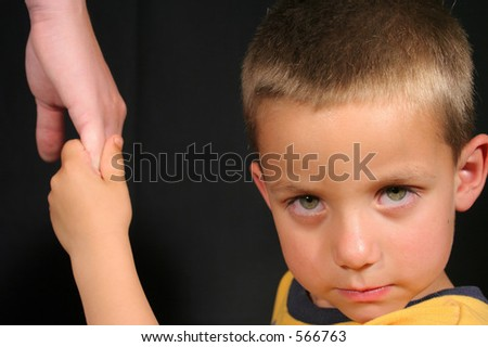 Child holding moms hand
