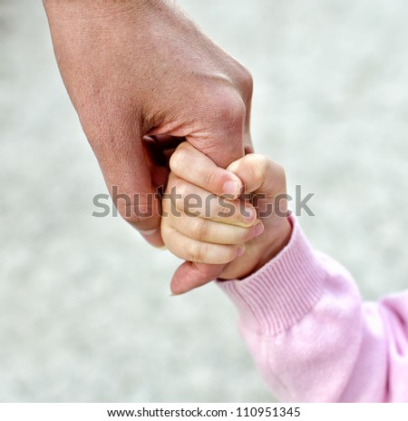 Child holding mother's hand