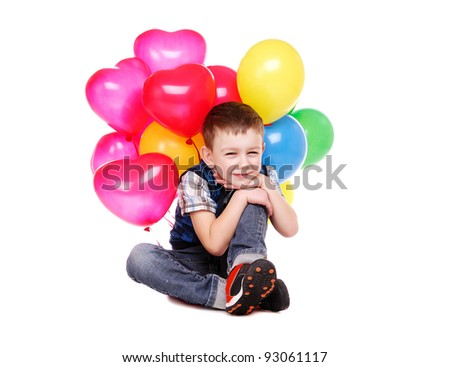 Child holding the bunch of balloons over the white background