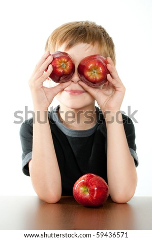 Child Holding Two Red Apples