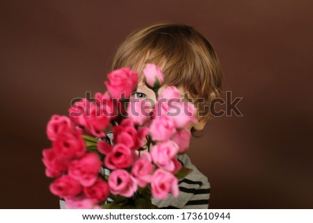 Child holding Valentine's Day flowers, roses
