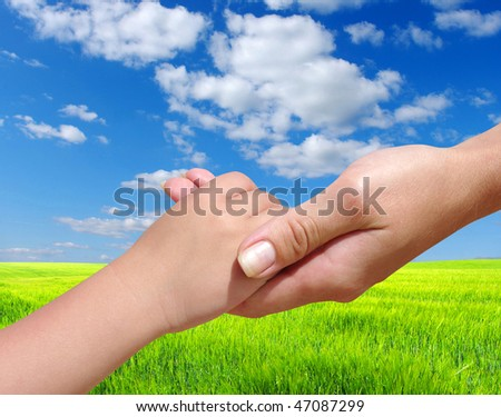 Child  holds the hand of the mother
