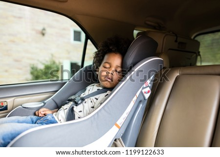 Child in a baby car seat