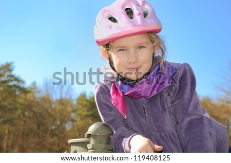 Child in a bicycle helmet.