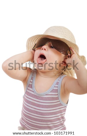 child in a cap with protruding tongue