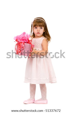 child in a white dress with a box in his hands