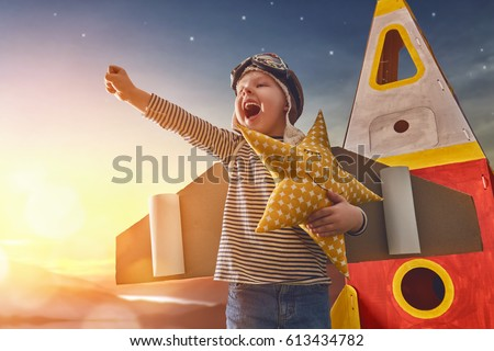child in astronaut costume with ...