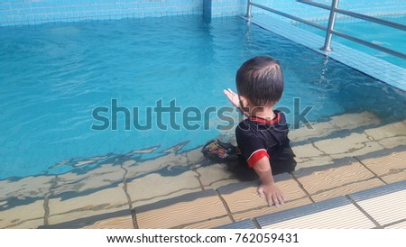 child in danger drowning in the ...