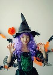 Child in Halloween costume. Kids trick or treat. Little boy with pumpkin lantern. Girl in witch hat.