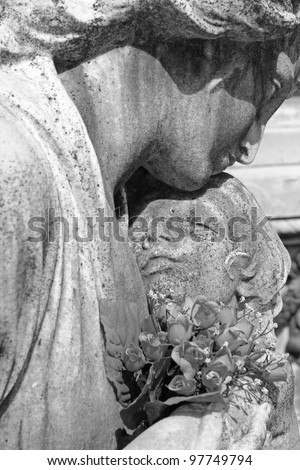 child in mother's arms - cemetery statue