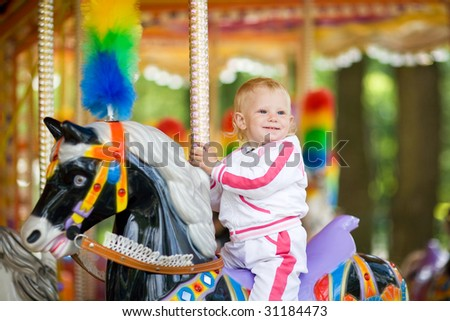 child in park of attractions