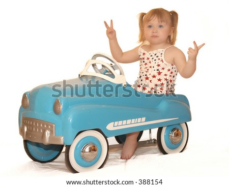 child in pedal car
