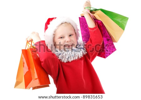 child in Santa cap with presents in bags