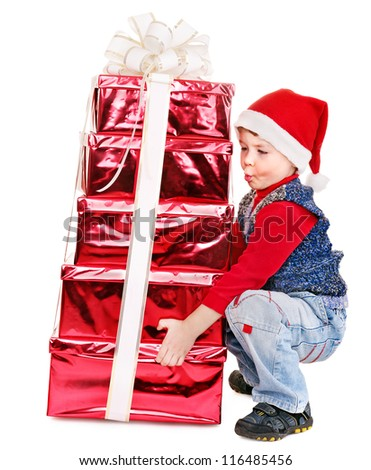 Child in Santa hat with stack gift box. Isolated.